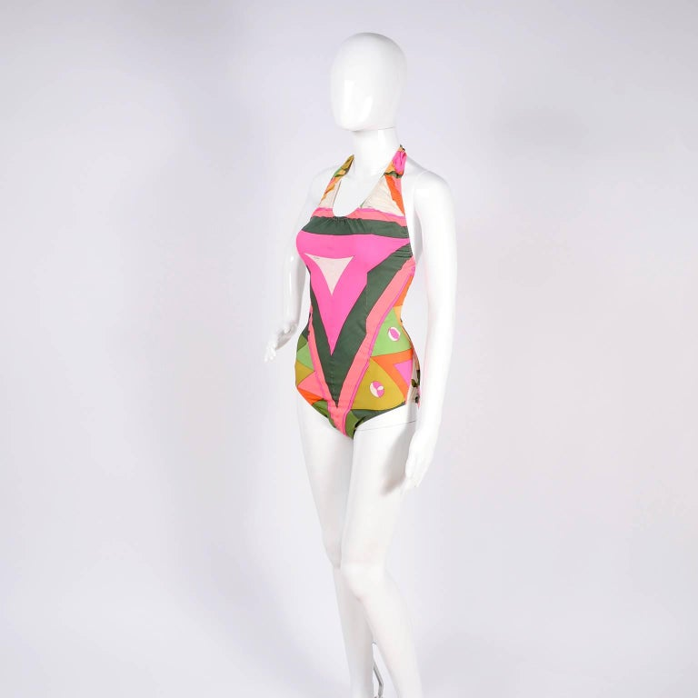 This is a fabulous vintage Pucci swimsuit from the late 1960's.  The suit fits a size Medium and has the Emilio Pucci signature print and the Emilio Pucci Florence - Italy label as well as the Exclusively for Saks Fifth Avenue Italy label.  The suit