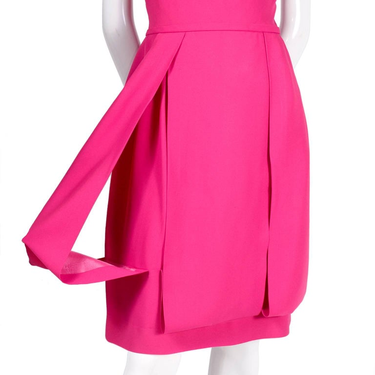 This is a very pretty pink vintage silk dress from the 1960's that was made for Saks Fifth Avenue.  The dress has really unique loop style panels in the skirt and is fully lined.  We are always looking for wedding guest and summer party dresses for