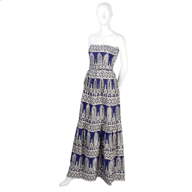 This is an absolutely gorgeous vintage Oscar de la Renta dress and jacket in blue with a metallic Byzantine pattern. This late 1960's or early 1970's 2 piece evening ensemble includes a strapless evening gown and a matching jacket.  The dress has a