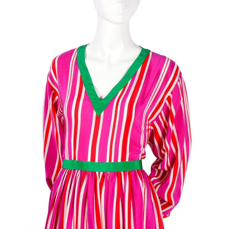 This is such a great vintage 2 piece silk dress from Oscar de la Renta.  The Miss O skirt and top ensemble is in a pink, red and white striped silk with green trim.  You can wear the V neck top with the skirt or as a separate piece.  This outfit was