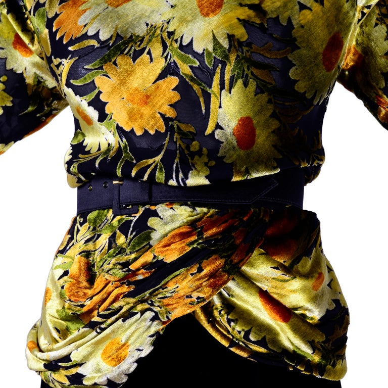 This beautiful 2 piece vintage dress from Valentino includes a burn out velvet top in a yellow, green, orange and black floral print and a slim black velvet skirt.  The semi sheer faux turtleneck long sleeved top is lined in a fine black silk,