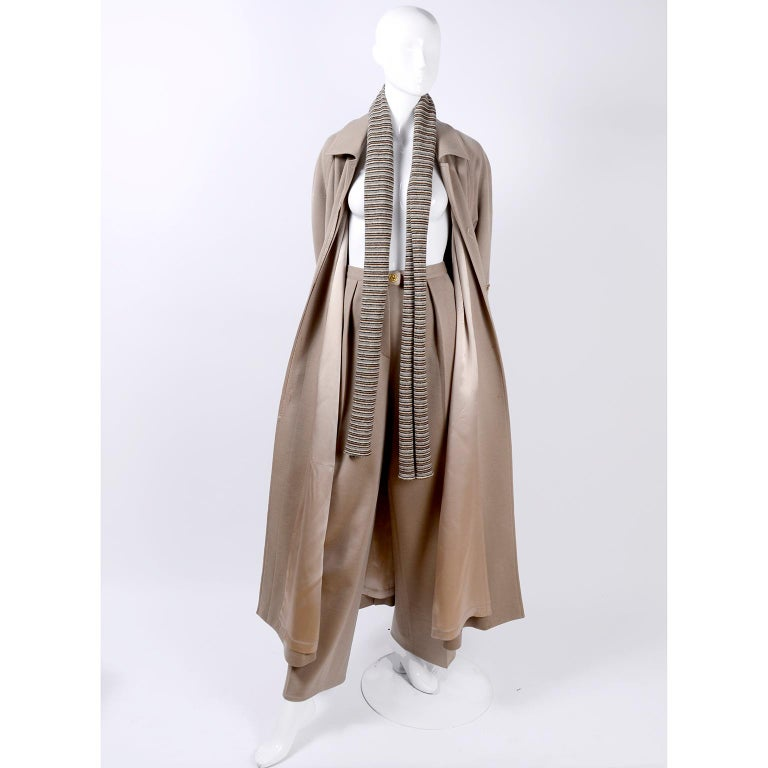This is a beautiful 3 piece wool ensemble from Sonia Rykiel, Paris. This is a great, versatile outfit  that includes a pair of high waist trousers, a wonderful lined long coat with a belt, and a striped scarf. This vintage pants suit came from an