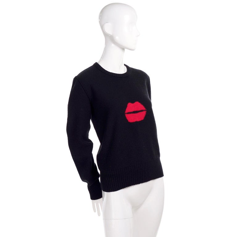 This is an iconic vintage sweater from designer Sonia Rykiel.  This great vintage black sweater is called the kiss sweater and is in a blend of 85% wool and 15% angora. There are red lips on the front center and the sweater is from the 1980's.  All