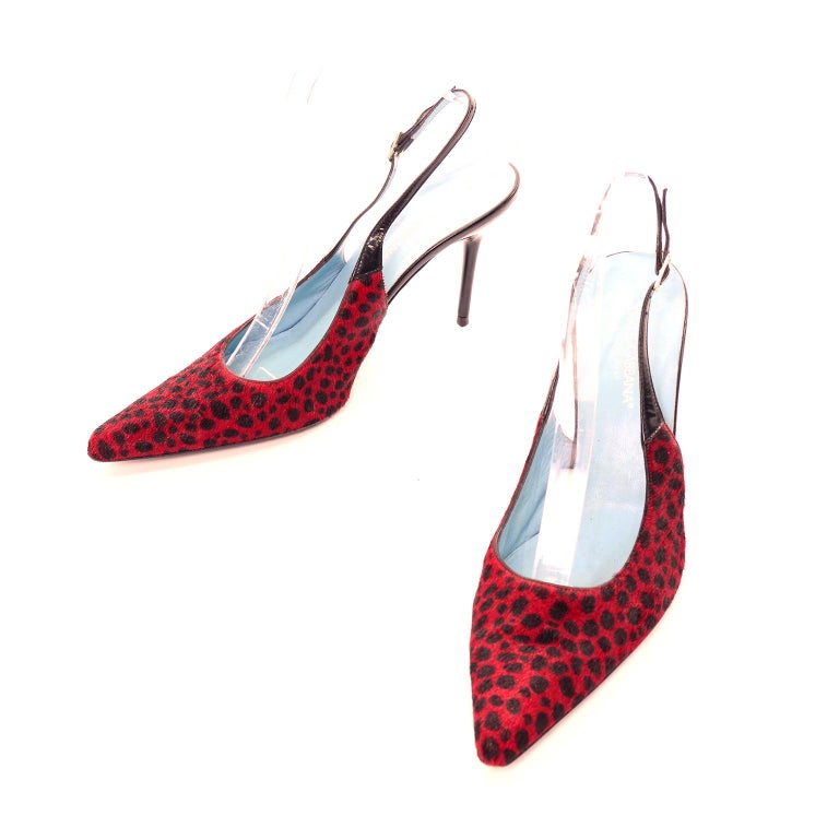 These are gorgeous Dolce & Gabbana shoes in a size Size 38.5. These slingback red and black spot animal print fur shoes have 4