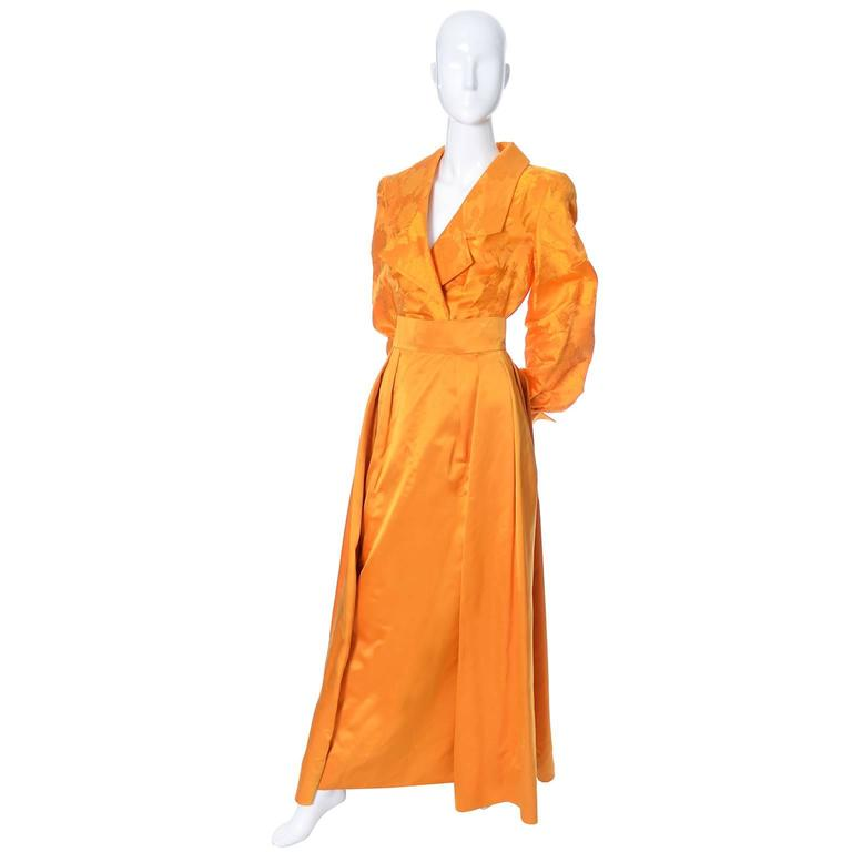 Luis Estevez vintage designer silk 2 piece dress in a gorgeous marigold silk.  Show stopping orange-gold vintage 2 piece evening gown with jacquard blouse and solid skirt with the estevez couture label. The blouse is a bodysuit and the solid silk