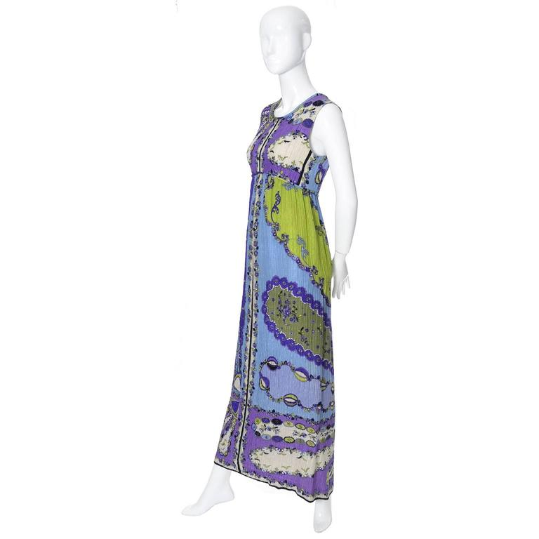 This fabulous vintage dress was designed by Emilio Pucci and purchased at Saks Fifth Avenue in the 1960's. The dress has an empire waist and is made from an incredible crinkle mod feather light silk in an op art print in shades of green, blue,