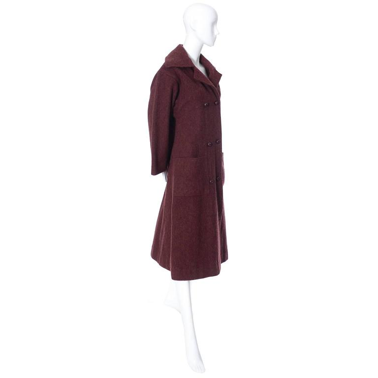 This is an outstanding double breasted vintage coat from Givenchy in a burgundy alpaca wool blend. This coat is the perfect coat for your winter wardrobe this year! Fully lined in luxuriously satin, this vintage Givenchy soft burgundy coat has