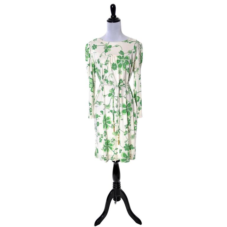 This is a vintage late 1960's signed Pucci print green floral silk jersey dress on ivory background with matching belt. The belt has fabulous gold tone end pieces with the initials EP for Emilio Pucci.  This dress came from an estate of several