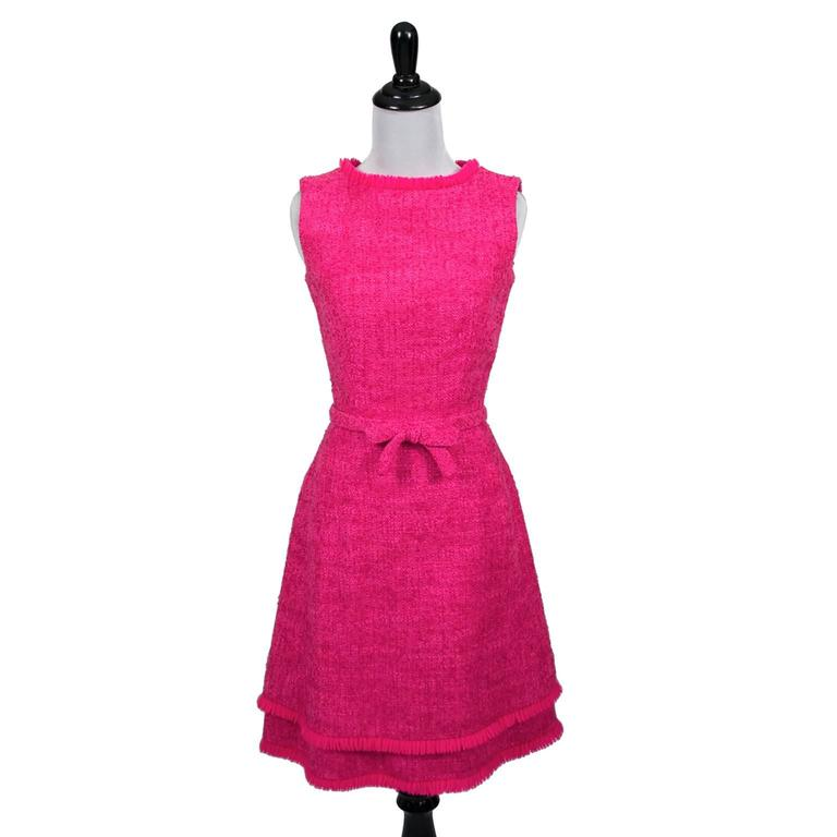 "This is a simply perfect hot pink classic late 1960's vintage sleeveless tweed dress with a beautiful double hemline. This Lanz Original dress has pretty fringe, a 20"" back zipper and 2 hooks and eyes at the neck. The dress has a fabric belt and a"