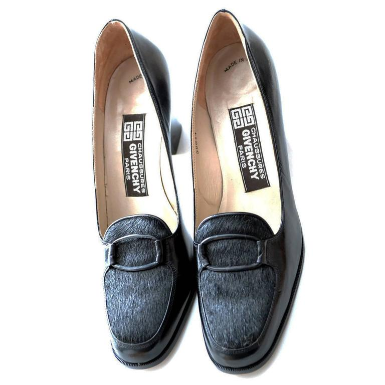 "This is a pair of exceptional Givenchy Paris Chaussures vintage ladies shoes from the 1970's. They are a size 8 ½ narrow black leather shoes with black fur trim and fabric covered buckle.  The heel is just under 3"", the width is 3"" when"