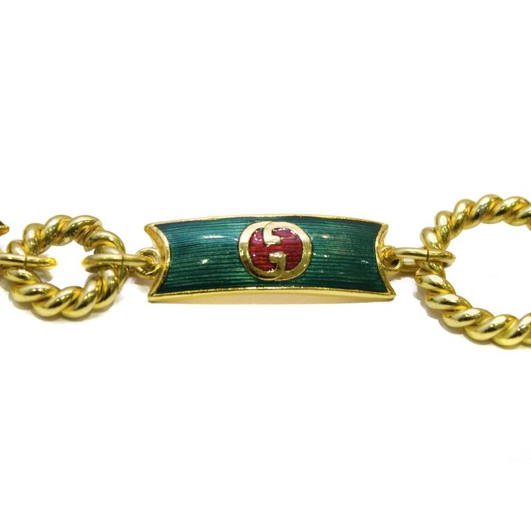Amazing rare Gucci green, red and gold tone metal belt from the 1970's. The green enamel coats each link with the Gucci logo in its centre, in red and gold. Loop and bar allows for an adjustable waist. Excellent vintage condition.