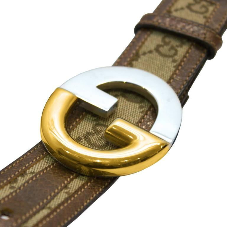 Classic Gucci canvas monogram belt from the 1970's featuring it's iconic print throughout, a GG belt buckle in goldtone and silver metal and a brown leather interior. Excellent vintage condition.