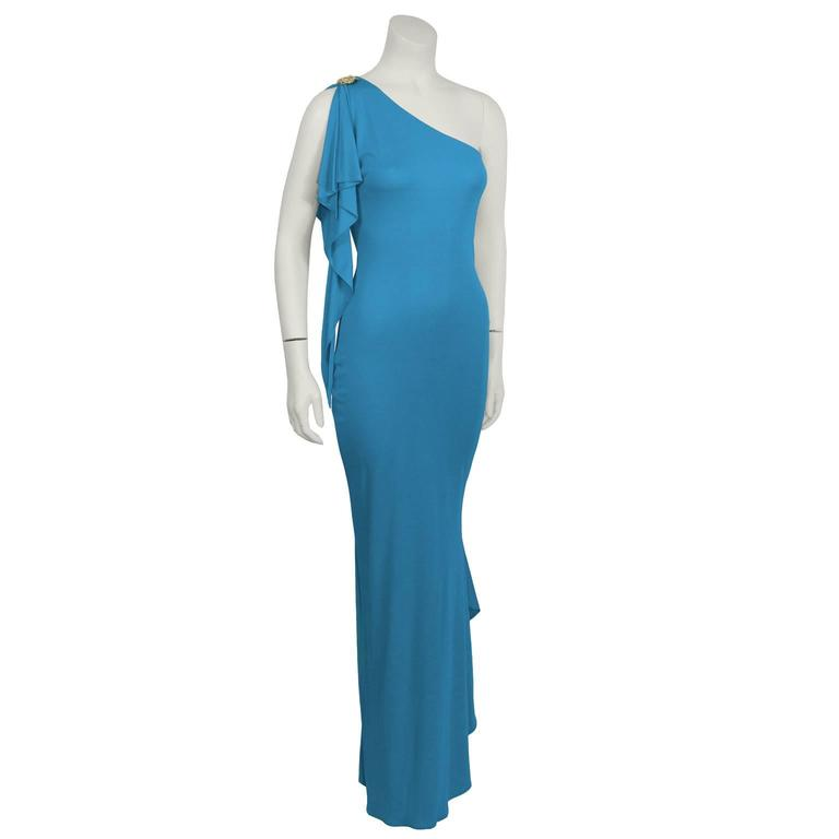 """Stunning Marc Bouwer one-shoulder gown from the 2000's is a vibrant blue, with a rhinestone pin on the shoulder. Mermaid fit, with an elegant cascading tail. Side zip closure. Excellent vintage condition.   Length 58.5""""   Bust 25""""   Waist 21""""  """