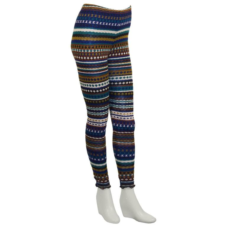 Adorable and cozy Missoni knit leggings from the 1980's featuring iconic stripes and zig zag lines in colors blue, green, mustard, brown, white and navy. Elasticized waist and a serge finished hem. Excellent vintage condition. Fits like a US 2.