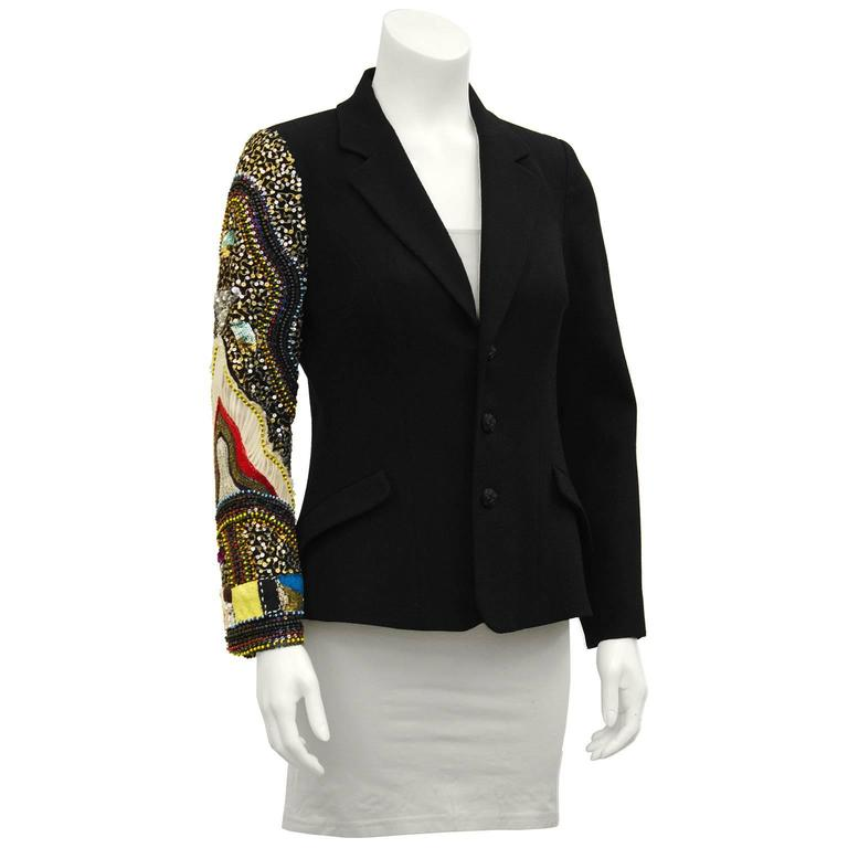 Unique Christian Lacroix jeweled sleeve jacket from the early 2000's. Classic single breasted black wool blazer with one bejeweled sleeve from shoulder to cuff. The look is simple with a twist, serious with a sense of humor. Excellent workmanship.