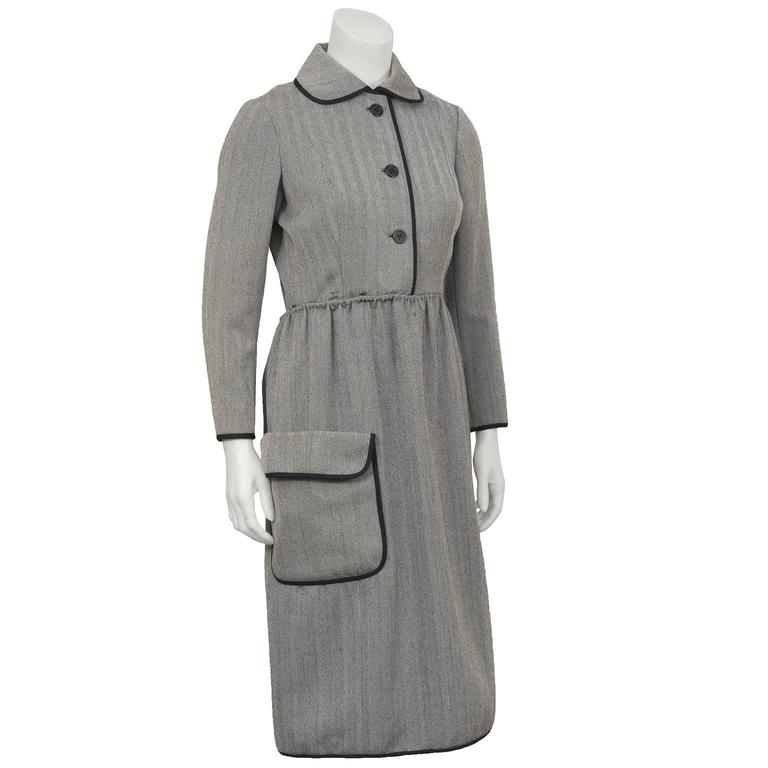 Chic 1960's Geoffrey Beene chocolate brown herring bone wool dress with exaggerated Peter Pan collar. Beautifully constructed with a series of buttons and hooks that allow the shirtwaist style skirt to wrap around and fasten in the back mirroring