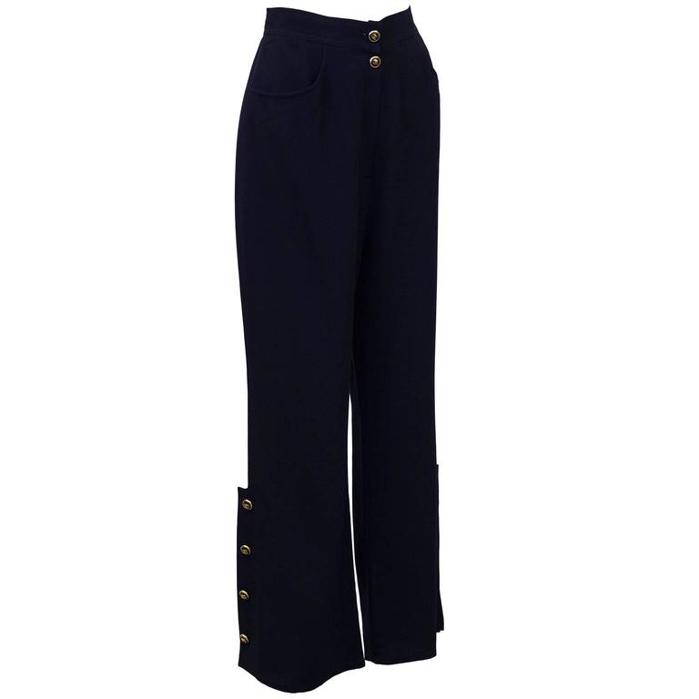Charming Chanel navy blue wool and silk blend pants from Spring 1998. Beautiful shape, accented with quintessential gold and navy blue Chanel cc buttons at waist and bottom of leg. Buttons on each leg takes these from being 'the classic' Chanel