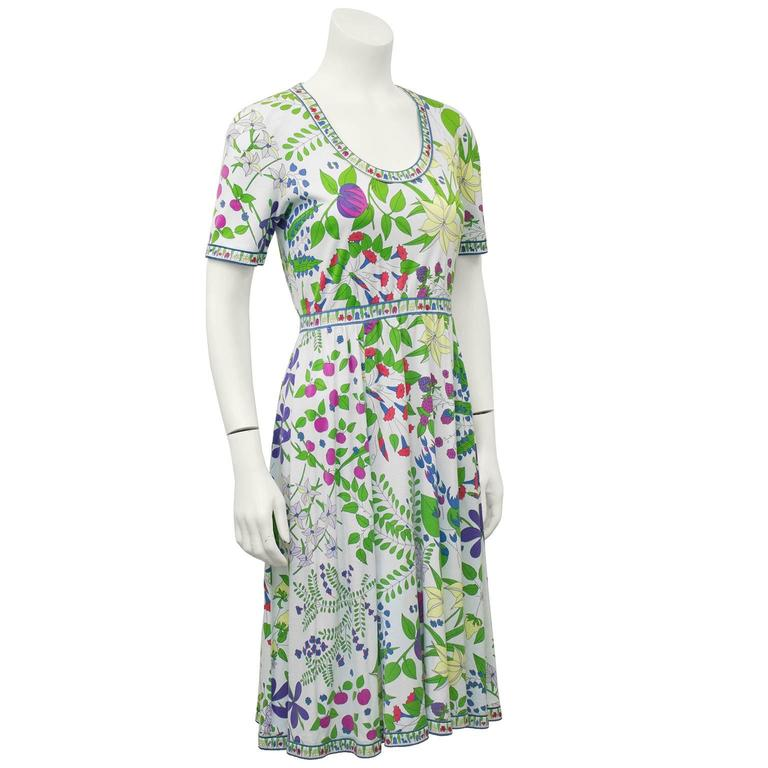 "Super sweet short sleeve, scoop neck Bessi day dress from the 1970's. Allover floral print over a white background. Perfect for a hot summer day, very comfortable and 100% combed cotton. Excellent vintage condition. US size 4.   Sleeve 6"" Shoulder"
