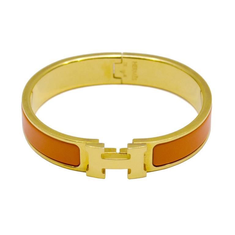 2007 Hermes Gold And Orange Clic Clac H Bracelet At 1stdibs