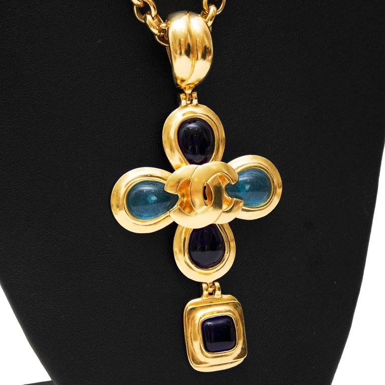 """Stunning Chanel necklace from the Autumn 1997 collection. Gold tone chain with large flower pendant with shades of blue poured glass. Hook closure with 2 CC logos on either side. In perfect condition. Comes with Chanel box.   Length 15""""  Pendent 4"""""""