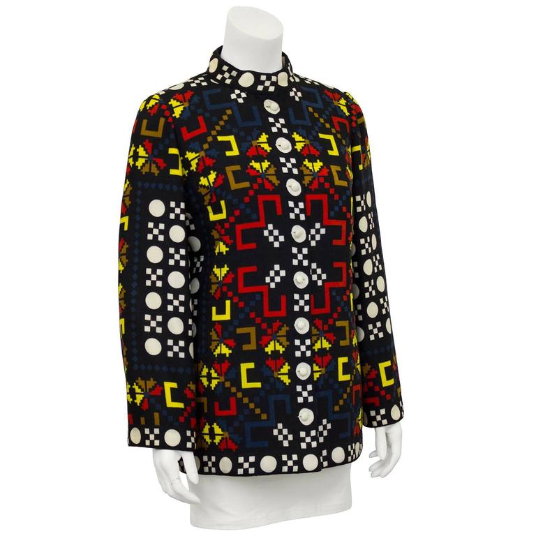 Charming and stylish light weight wool Lanvin jacket from the 1980's, featuring a bold primary color graphic print. White buttons down front avoid disrupting the print. Very slight bell sleeve Lightly lined on the interior with channel quilted rayon