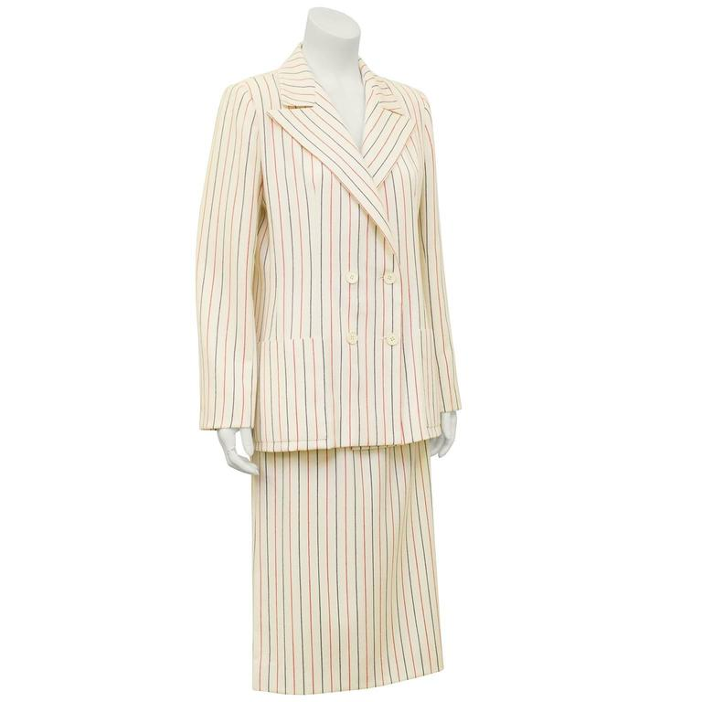 1980's Scherrer cream with red and navy blue pin stripe wool skirt suit. Double breasted jacket with cream buttons, oversized collar and patch pockets. High waisted knee length skirt. Can be work together or separately. Excellent very good vintage