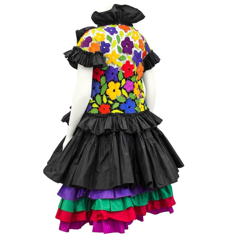 1980s 3 pc ensemble by Canadian demi couture designer Maggie Reeves. Black silk taffeta bustier, taffeta skirt with multi colour layers and macrame floral multi colour jacket with black taffeta trim. Can be worn all together for a fab evening look