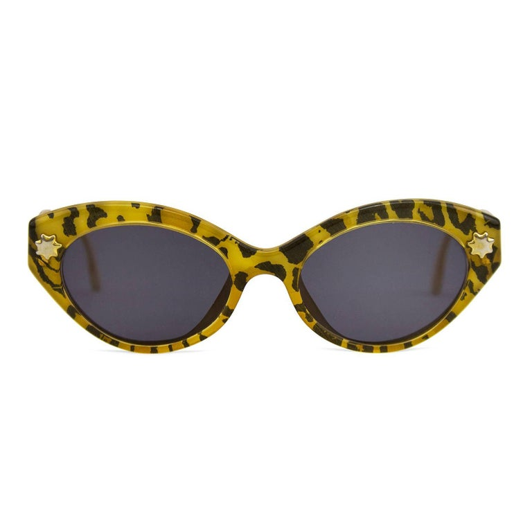 1980s Christian Lacroix cat eye shaped leopard print sunglasses. Small gold star and logo details. Cream interior with black brand stamp. Brand new black/grey lenses. Excellent vintage condition. No case.
