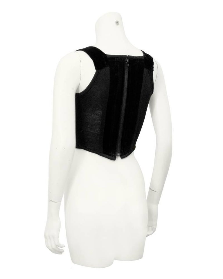 """This 1980s iconic Vivienne Westwood bustier features velvet panels down the front and back and a spandex like material down the sides. Boning throughout, zipper up the back. In excellent vintage condition. Fits like a US 2/4.  Bust 32""""  Waist"""