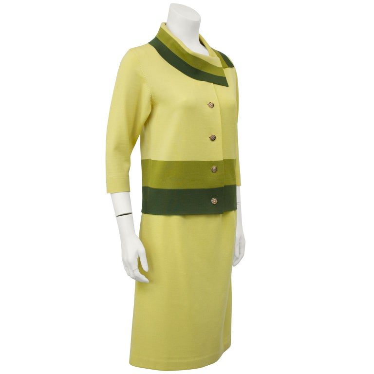 1960's Italian knit skirt suit with color block banding across the bottom and collar of the single breasted jacket. Short 3/4 length sleeves, made in Italy by Lucia, typical of the high quality fashion knits that were so popular in the 60's. Acidy