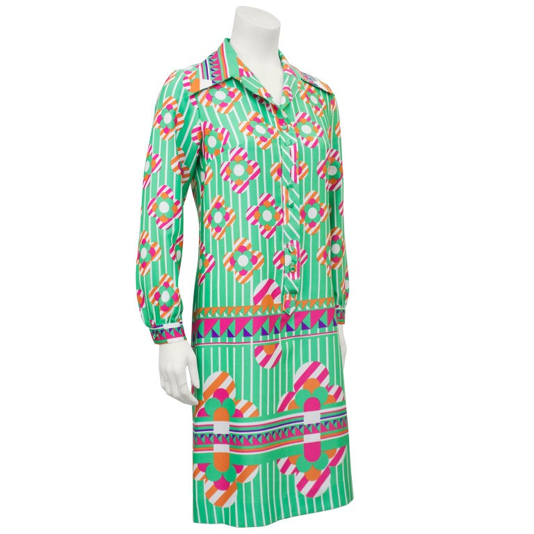 6b6531c2f07a This amazing poly blend Lanvin printed shirt dress from the 1960s is flower  power with a