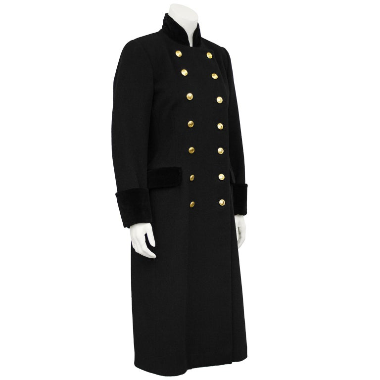 Christian Dior black military style coat from the 1980s. Black wool with black velvet cuffs, collar and pocket flaps. Double breasted with gold CD buttons. In excellent condition, fits like a US 4-6.