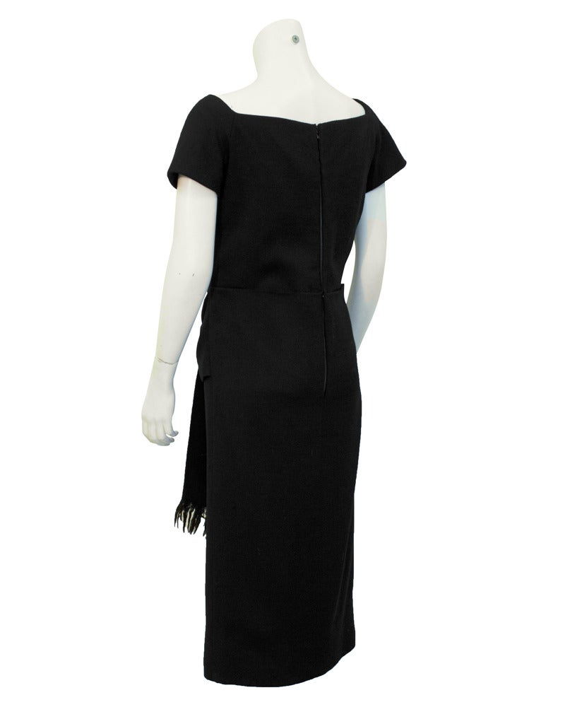 Fabulous black Christian Dior pre-1957 fine wool dress with a wide square neckline and fringed tie detail at low waist. The dress is a Dior London ready-to-wear piece and dates to the time the Dior boutique labels were still designed in Paris.