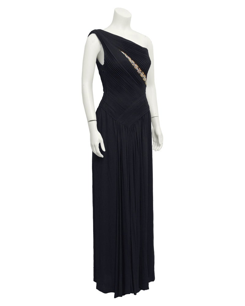 Elegant Grecian style one shoulder evening gown in black with gold and rhinestone bead work inserted into the tuck pleated bodice. Lancetti was a  couture house in Rome in the 1950's and 60's presenting cocktail and evening wear for discriminating