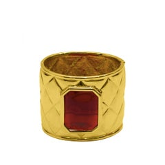 Late 1980s Les Bernard Gold Quilted Cuff with Red Poured Glass Stone