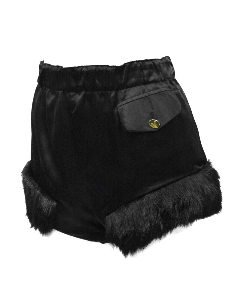 Unusual late 1980's to mid 90's black satin Vivienne Westwood hot pants purchased in the early 2000's  at  Christies South Kensington from the Vivienne Westwood archives. These saucy short shorts have one pocket on the left side (when wearing) and