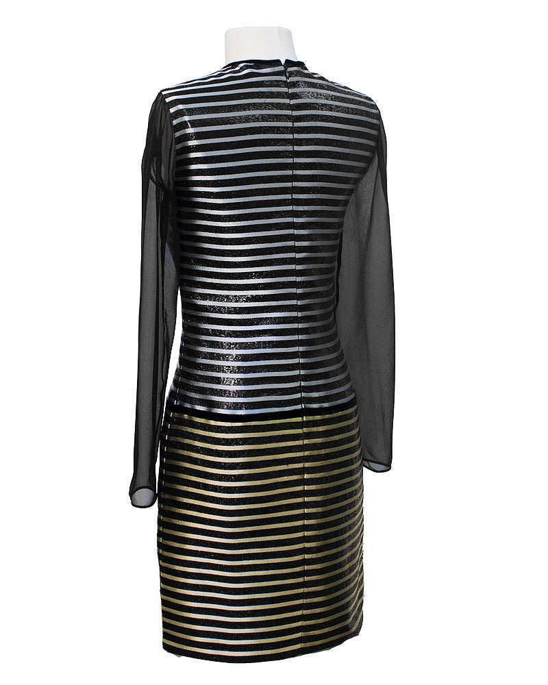 The sleek, elegant, minimal look of this 1980's haute couture Galanos cocktail dress is hard to deny. Finding a dress that is perfect for evening is a challenge. Silver, gold and black with a simple waist fitted silhouette, enhanced with a touch of