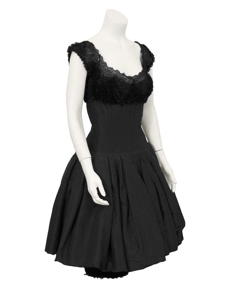 Black silk taffeta and scrunched lace cocktail dress with pouf skirt, cap sleeve and lace bodice finished off with a sexy pencil narrow underskirt. The look is sophisticated 1960's New York socialite. Excellent vintage condition. Narrow fit through