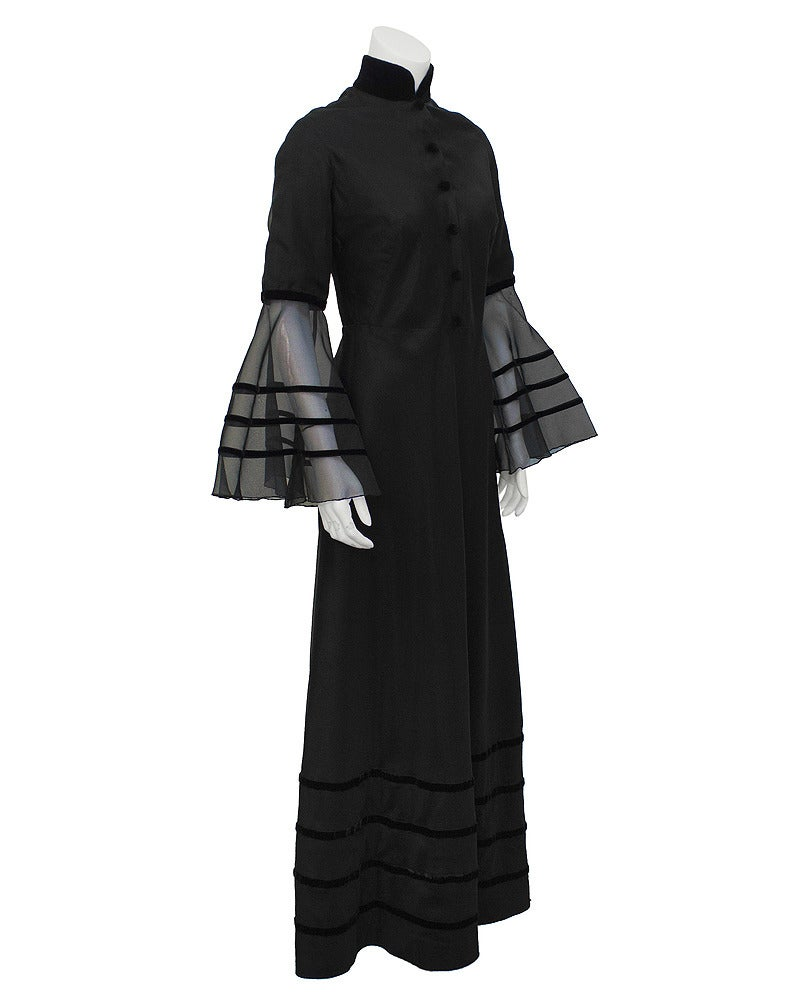 Stunning late 60s Biba-esque dress by the highly collectible British label Annacat. Fitted bodice with a fuller skirt featuring striped velvet details on the lower half. Decorated half the way down the front with exquisite covered velvet dome