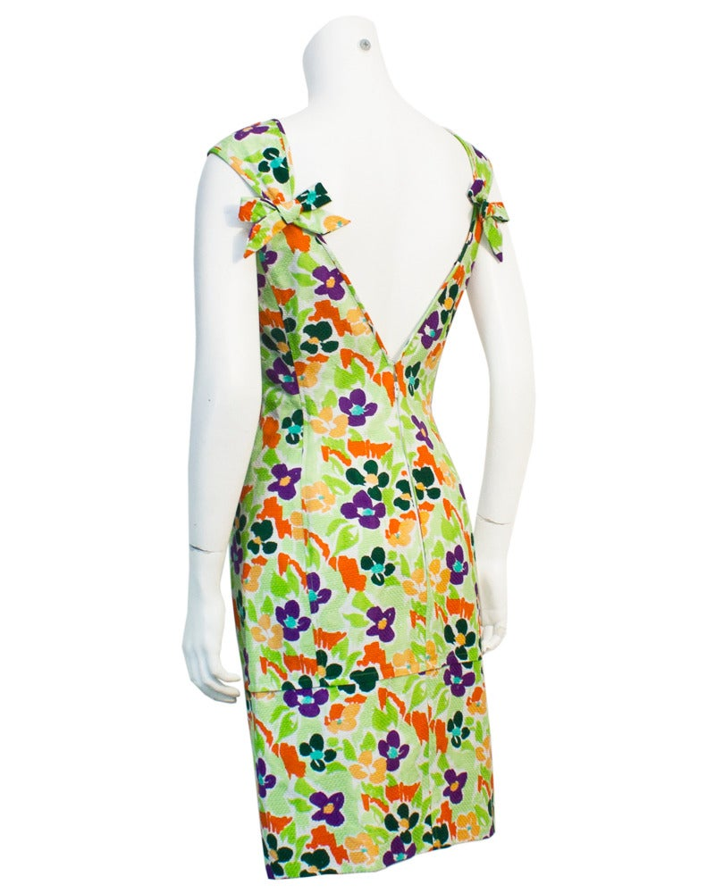 Sexy cotton floral Ungaro cocktail dress/day dress in pique with vibrant green, orange and purple flowels. Fresh enough for a visit to a tropical wedding, perfect for a cruise or just a great addition to your wardrobe. Circa 1980. Excellent vintage