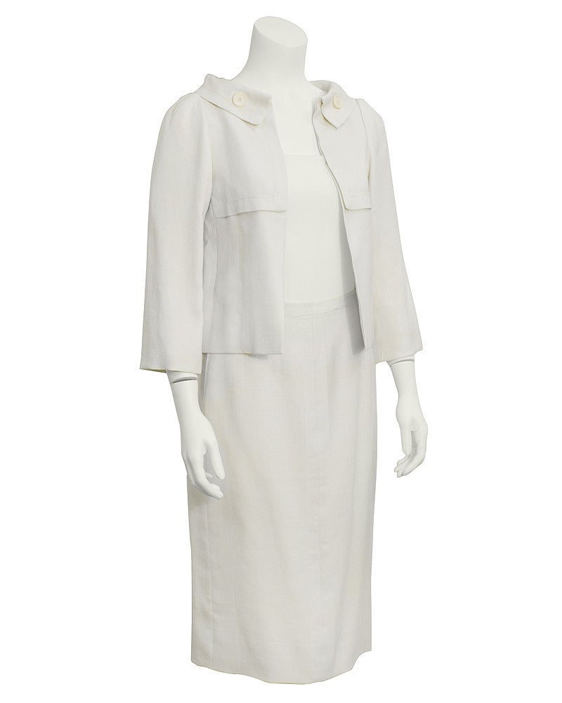 Spring/summer 1963 Christian Dior Couture cream linen jacket and skirt. Jacket is open front with a wide shawl like collar with a cute matching cream button on both sides. Bracelet length sleeves and beautiful stitching detail along the collar and