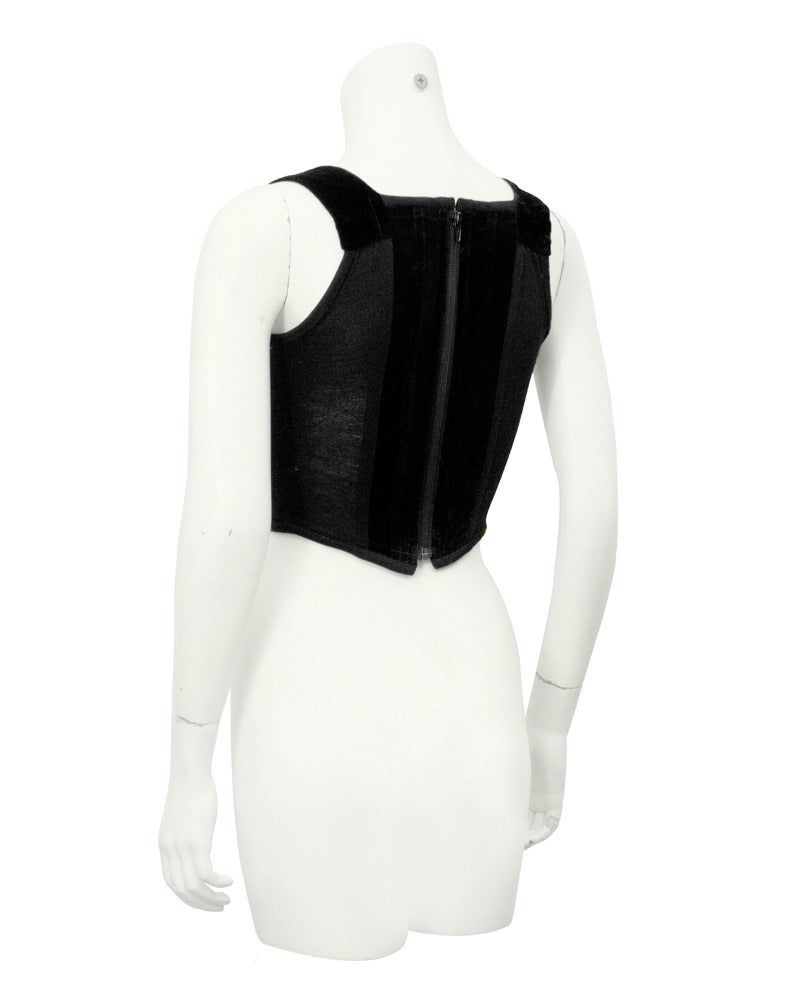 Purchased at auction in London in 2005 from the private collection of Vivienne Westwood. This 1980's bustier features velvet panels down the front and back and a spandex like material down the sides. Boning throughout, zipper up the back. In