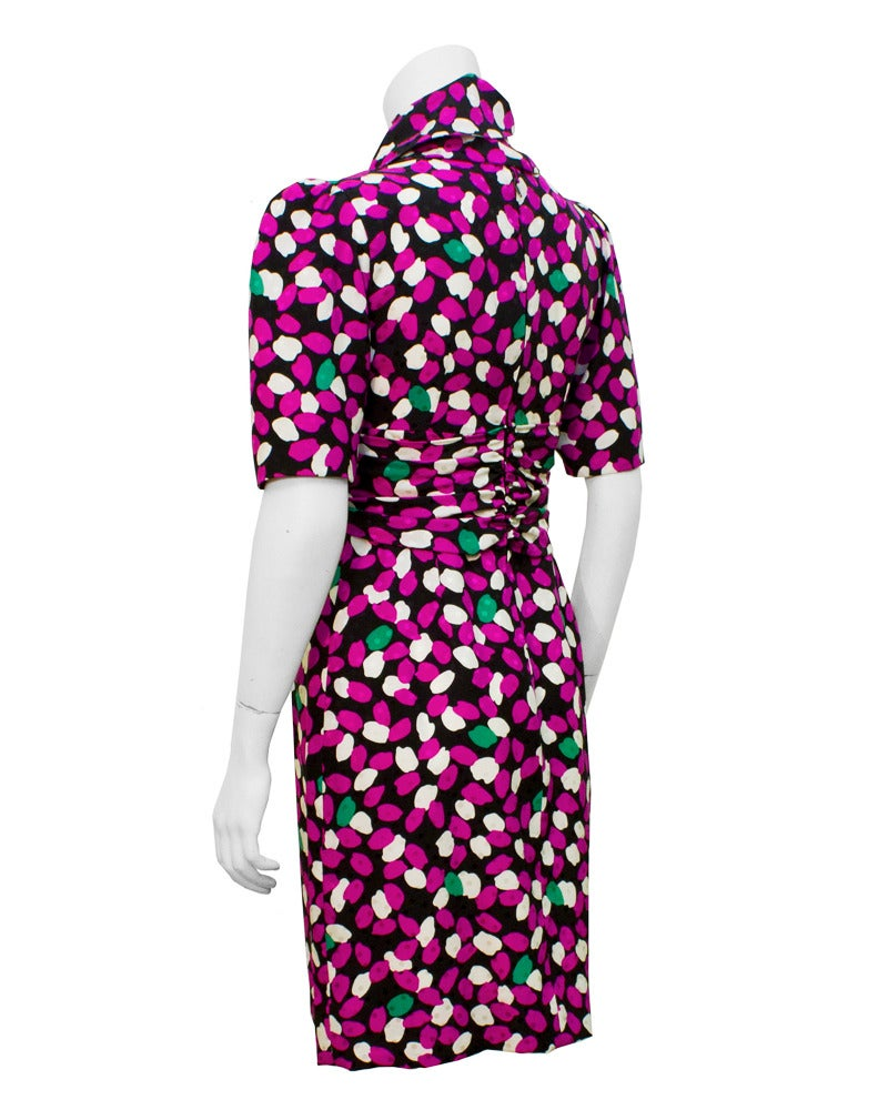 Fresh and feminine! Lovely 1980's Givenchy silk printed dress with detached tie collar/peplum belt. We show this piece with the neck tie option however the tie-up can be worn around the waist to add a peplum feature. Very versatile.  Excellent