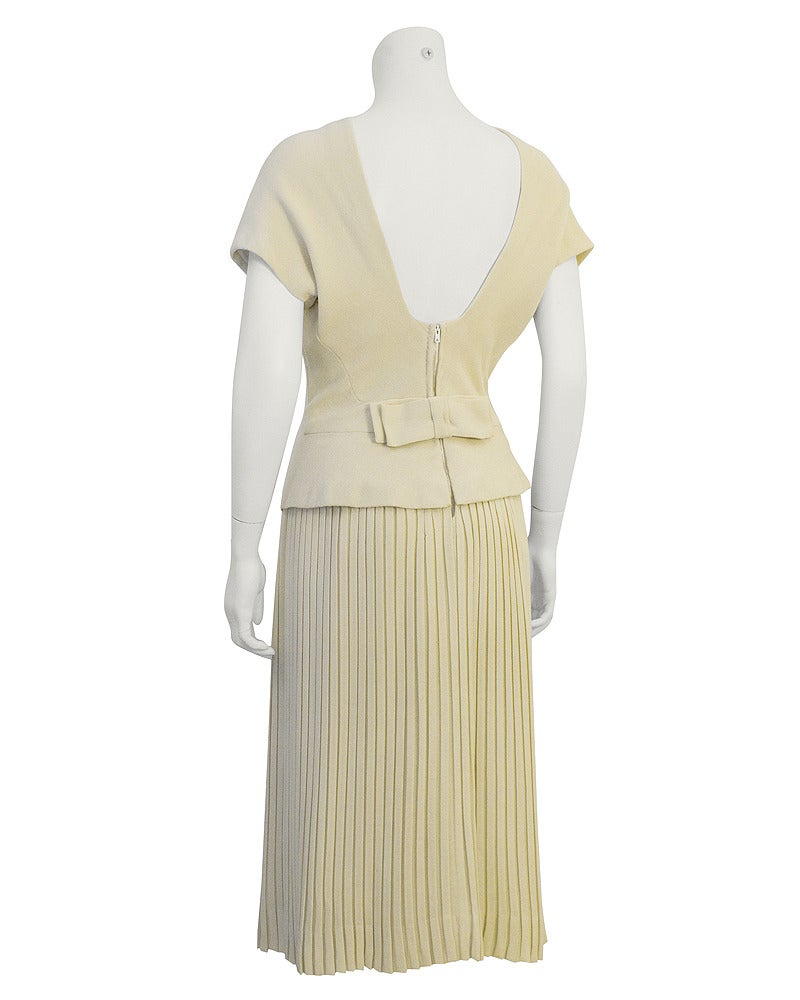 861d604e7969a Beige 1940's Manguin Cream Dress with Pleated Skirt and Bow Detail For Sale