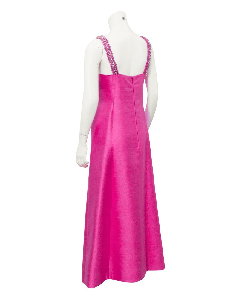 Pink silk shantung gown by Traina/Starr fashion line, Gino Charles, from the 1960's. The neckline and straps are decorated with beading in the shape of flowers and the cut away styled bodice flatters all shapes. The stiff fabric helps the dress keep