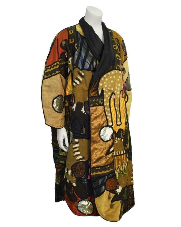 Art-to-Wear 1970's vintage hand decorated multi fabric Mexican themed coat. Very collectable as art or fashion. In unworn vintage condition. Unstructured and forgiving in fit. A great conversation piece.