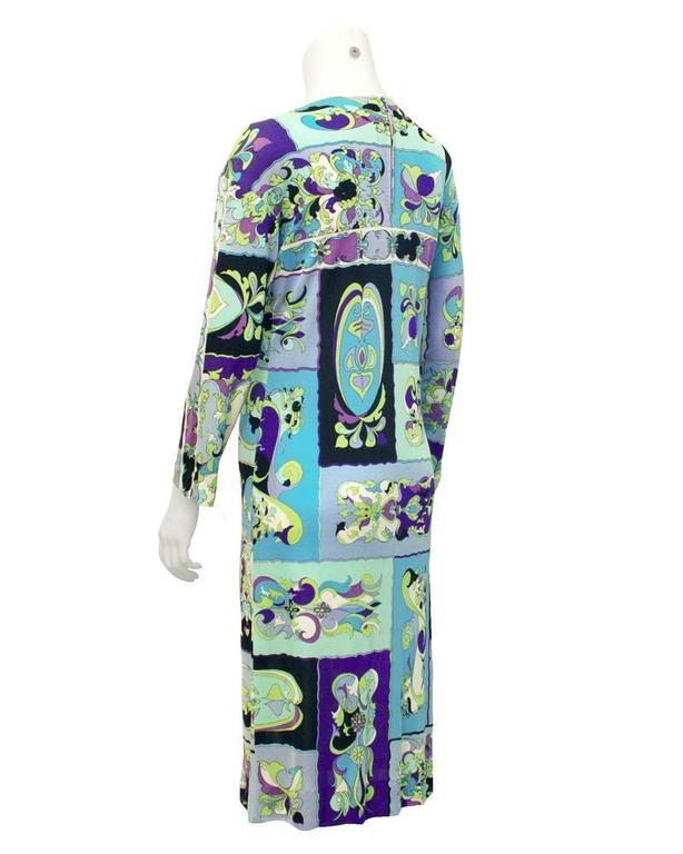 Classic silk jersey dress from the 60's, a combination of blue, green and black Pucci print. Looks great for all seasons. Zipper up the back of the neck. In excellent vintage condition.