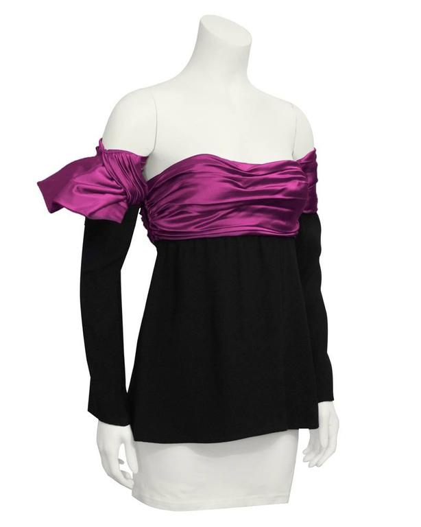 1980's Lanvin strapless top with optional sleeves. The bright fushia banding along the bust line continues onto the upper part of the sleeves, giving the illusion that they are one piece. Can be worn separately. The sleeves slide on. In excellent