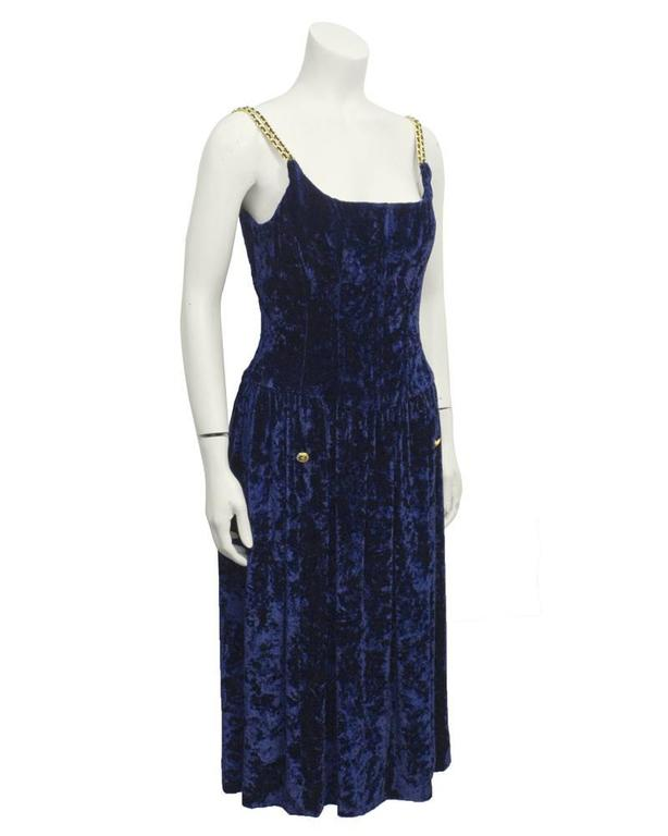 Chanel navy panne velvet dress with corset bodice. This dates from the early 90's collections and is highly treasured for its fit and the Chanel chain details. Good gold and navy buttons, fully lined in silk. Excellent vintage condition.  Fits like