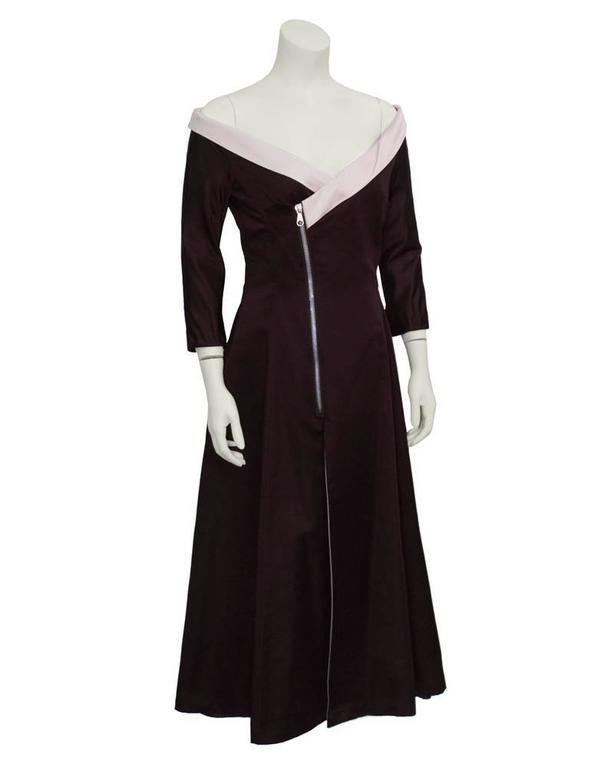 Interesting Stella McCartney for Chloe silk dress from the 1999-2000 collection in stunning plum satin finished with a pink off-the shoulder neckline. Asymmetrically cut, with a dramatic metal diagonal zip closure on front. Skirt is flared with a